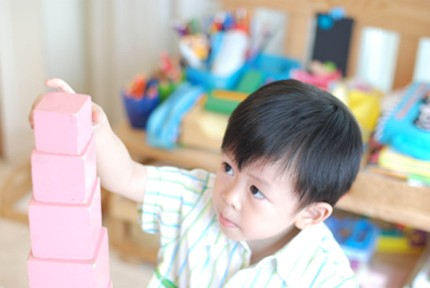 Joseph, 4, building the Montessori pink tower